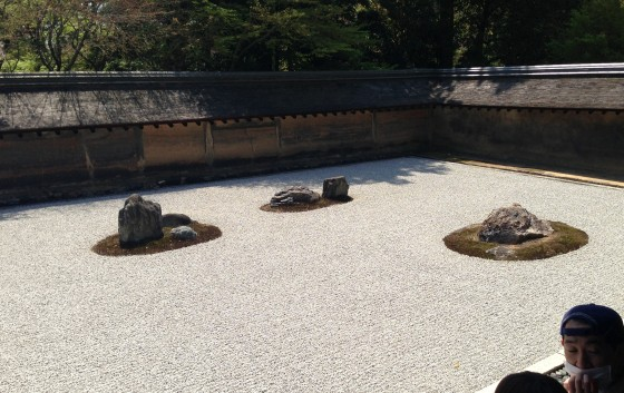 Zen garden with 15 rocks placed in formation and surrounded by striated gravel. We paid $10 for the privilege.
